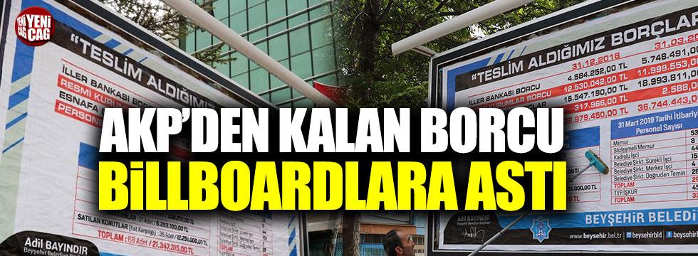 AKP'den kalan borcu billboardlara astırdı