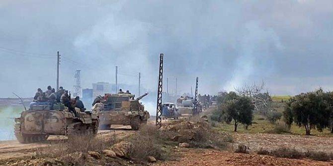 Esad güçleriyle muhalif gruplar arasında çatışma