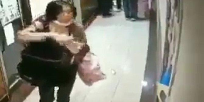 Çinli olduğu öne sürülen kadın korona virüs yaymak için asansöre tükürdü