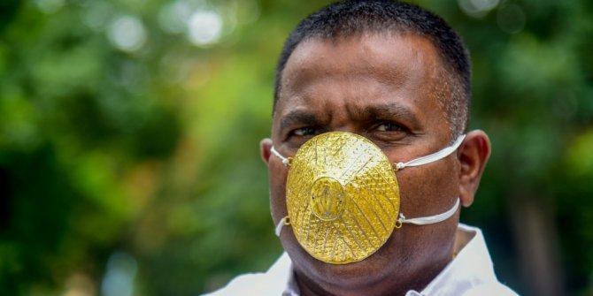Korona virüsten korunmak için altından maske yaptırdı
