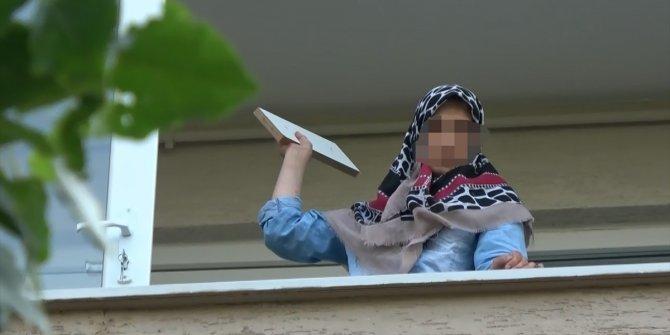 Sinir krizi geçirdi, evindeki eşyaları camdan attı, gözaltına alındı