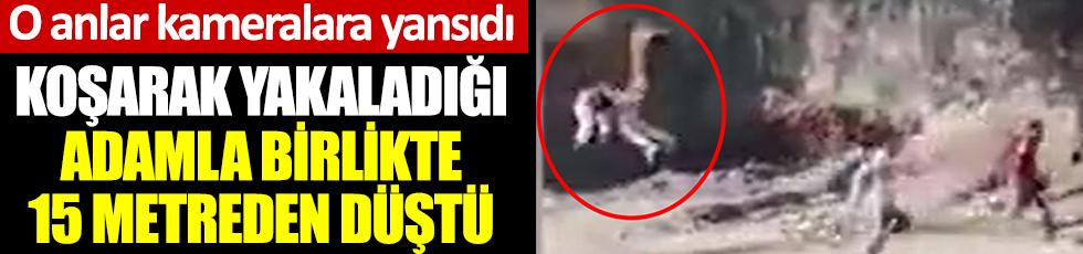 Koruma alanından kaçtı. Koşarak yakaladığı adamla birlikte 15 metreden düştü. O anlar kameralara yansıdı
