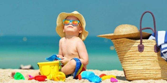 Çocuklarda güneşin zararlı ışınlarına dikkat edin