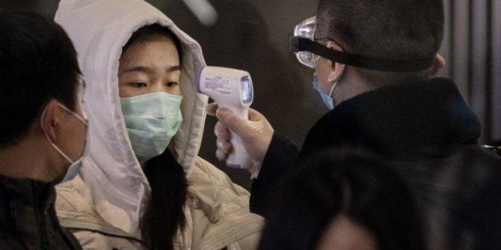 Pekin'de maske takmayana gözaltı geliyor