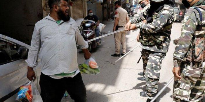 Hindistan'da yasağa uymayanlar sopayla dövülüyor
