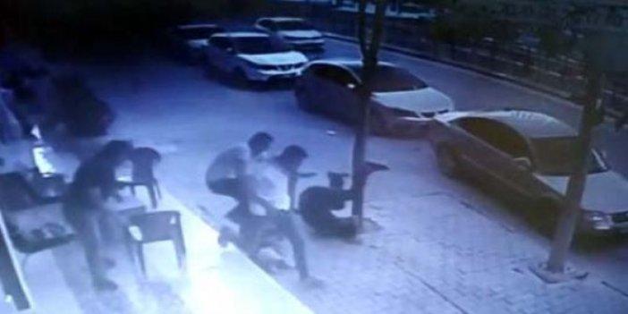 2 yaşındaki çocuk 6 metredenoturan adamın üstüne düştü
