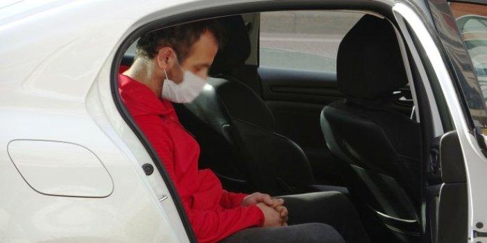 Bursa'da ilginç anlar. Kısıtlamaya uymadı, polise yakalandı. Ceza yazılırken arabada uyudu