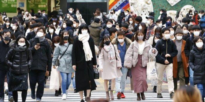 Japonya Başbakanı'ndan halkına işbirliği çağrısı. Virüs tatil dinlemiyor