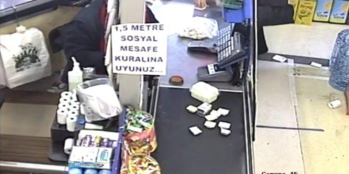Karabük'te markette akılalmaz olay. Kasanın üzerinde gördü gözünü kırpmadan çantasına koydu
