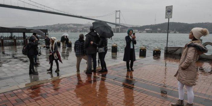 Yağmur yağsa da İstanbul'un keyfini onlar çıkartıyor